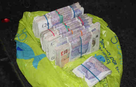 Op Quadrant Bundles of cash seized 2