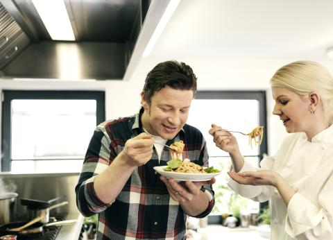 Jamie Oliver testing food at Scandic