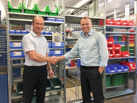 Købsaftalen blev underskrevet d. 3. august af administrerende direktør for SSI Schäfer North & East Europe, Ole Madsen, og SNS Nodalas administrerende direktør Einars Kizjalo