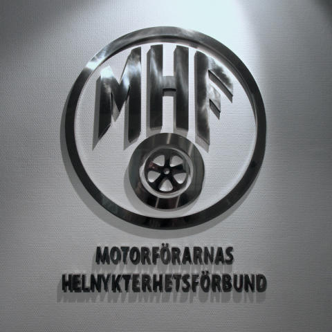 Skylt MHF, från clarex