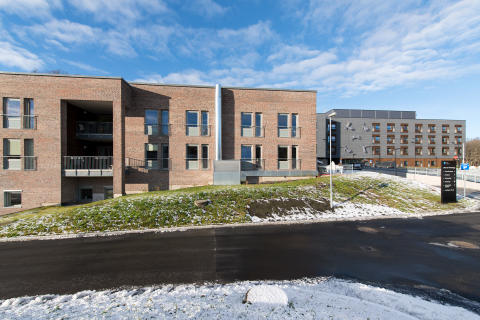 Bygging av Norges største pleiehjem i massivtre krever en brannsikker fasadeløsning.