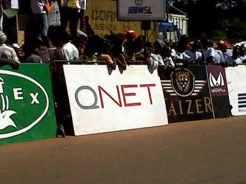 The QNET logo was displayed prominently throughout the race