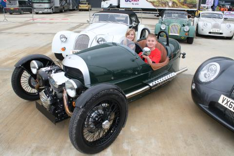 Patient Rafe and his sister Clemmie in a Morgan racecar