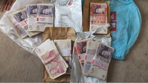 Cash found in the home of Nazrul Islam