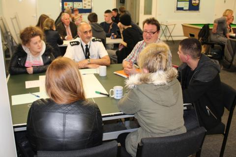 GMP Chief Inspector Nadeem Mir (centre left) and Cllr Andy Kelly (centre right) discuss the issue of how young people are judged on their dress