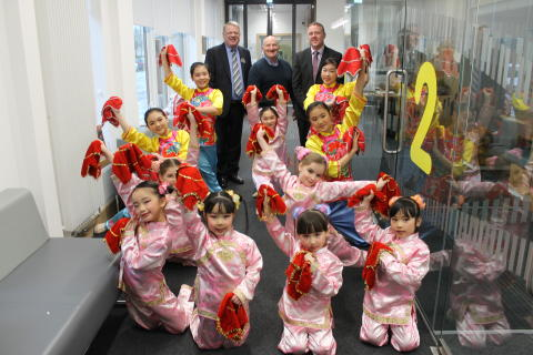 Local families Celebrate Chinese New Year in North Glasgow. ng homes Chairperson John Fury and CEO Robert Tamburrini are joined by Bob Doris MSP and dancers from Glasgow Oriental Dancing Association.