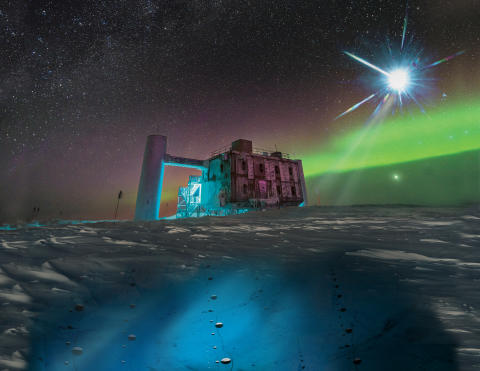The IceCube Lab at the South Pole with aurora
