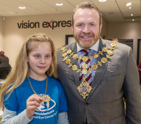 Hereford opticians welcomes child eye cancer survivor as revamped Vision Express store opens its doors