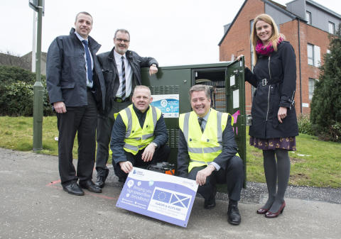Cabinet Secretary splices fibre as rollout reaches milestone