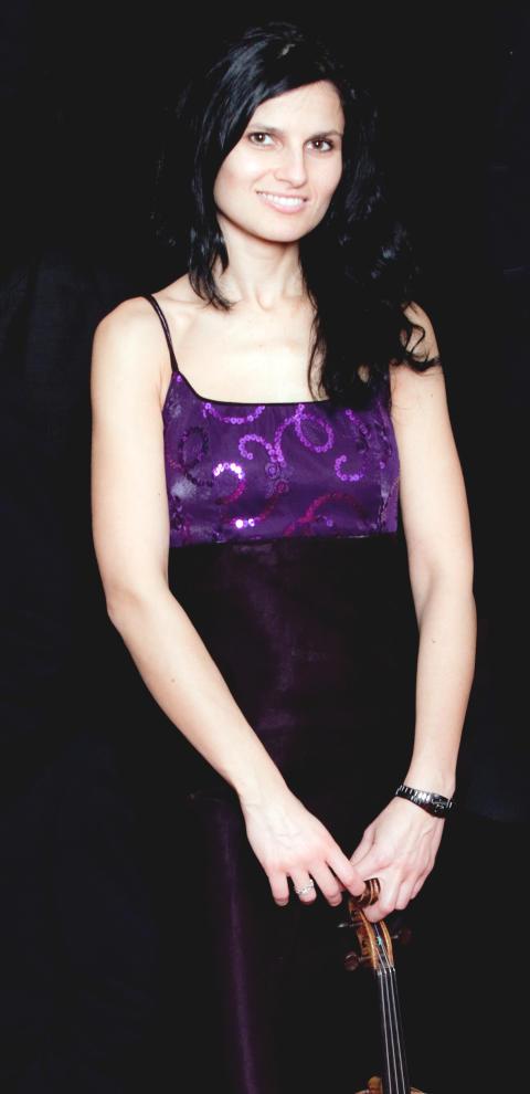 Corina Belcea, standing with violin