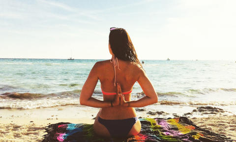 Reverse Anjali Mudra Beach Yoga_Source NOSADE