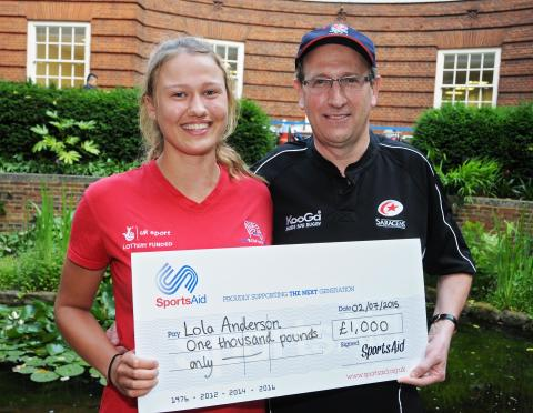 Rower Lola Anderson, 17 from Twickenham, receives a £1,000 SportsAid award from Rayner Essex partner Tim Sansom