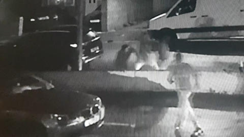 CCTV still image of incident and suspects