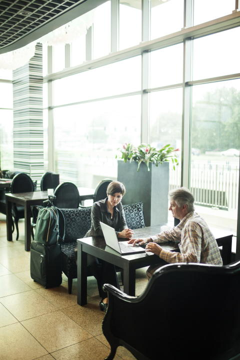 Man and Woman using the HP EliteBook Folio 9470m in an open space