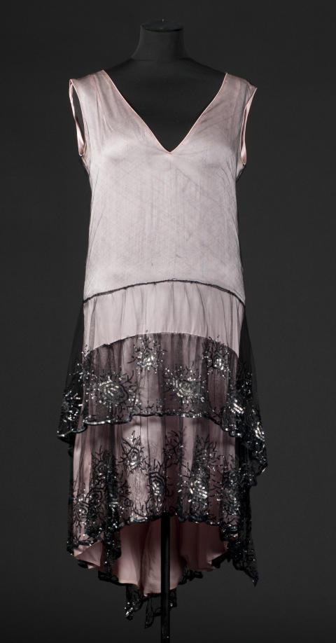 Blekrosa klänning