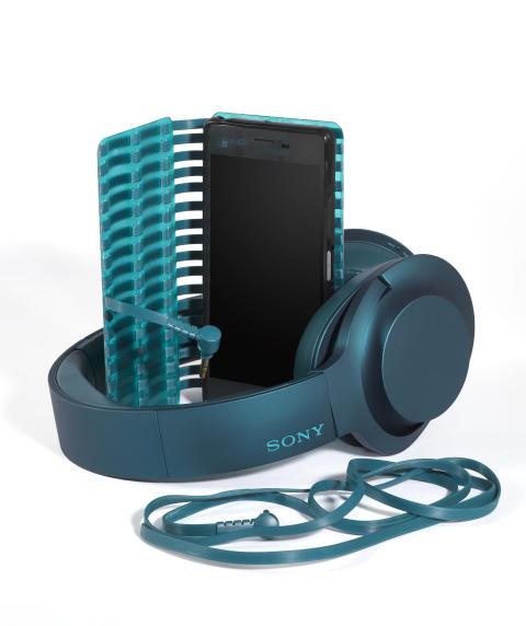 sony h.ear on blue headphones with phone case