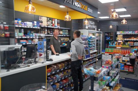 Serving customers at Nisa store, Elstree & Borehamwood