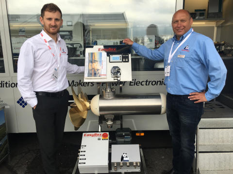 Hi-res image - Fischer Panda UK - Chris Fower, Sales and Marketing Director, Fischer Panda UK, and Martin Mews, Diesel-Electric Propulsion Systems Specialist at Fischer Panda GmbH, with the new 100 kW electric motor at Seawork International
