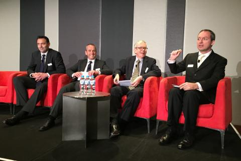 Mark Laudi moderating panel in Sydney