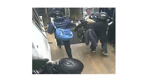 Sheraji (with blue bag) CCTV still 2