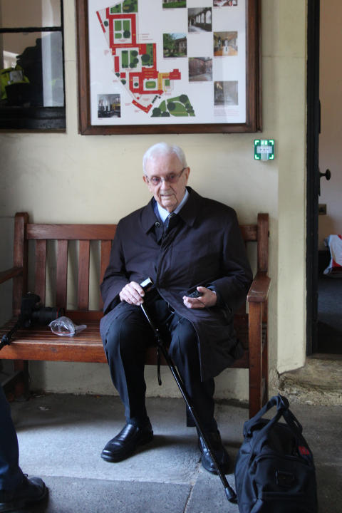 Jimmy, waiting for Stanley at the almshouse entrance