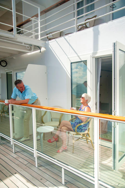 Couple sitting out on Room Balcony