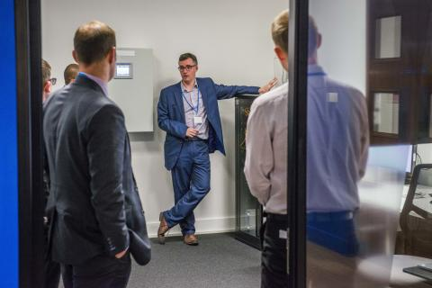 Euan Davidson, Production Engineering Director, shows attendees the new lab in Glasgow