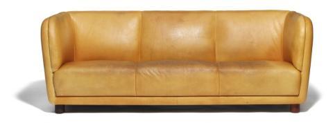 "Arne Jacobsen's ""Novo"" sofa with round mahogany legs."