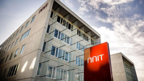 NNIT settles an arbitration with a public customer and changes outlook for 2017