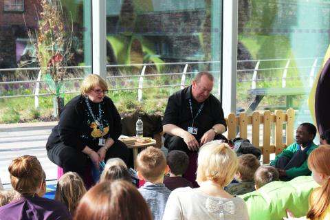 EASTER FUN: Young Persons' Library Worker Ray Stearn reading stories, with town centre chaplain Reverend Margaret Smith