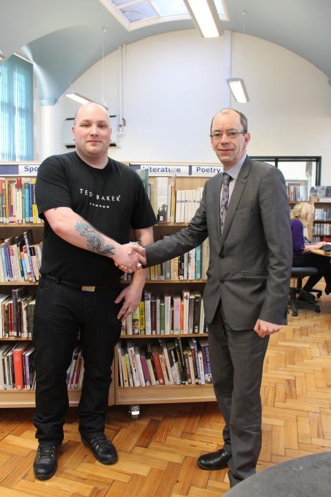 THANKS: Autistic poet Adam Souter with Rochdale Borough Council's leader Councillor Colin Lambert