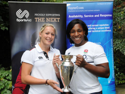 Maggie Alfonsi and Natasha Hunt with the women's Rugby World Cup at a SportsAid fundraiser in London
