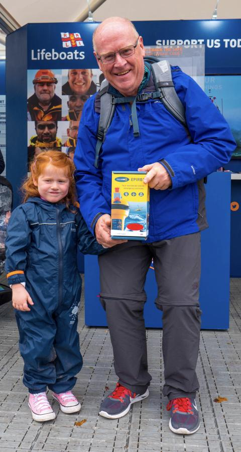 Hi-res image - Ocean Signal - A show visitor and his grand-daughter won the Ocean Signal rescueME EPIRB1 in the RNLI's 'Crack the Code Safe' giveaway at Southampton Boat Show