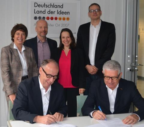 HdWM Partner des Spitzensports: Kooperation mit Olympiastützpunkt Metropolregion Rhein-Neckar in Heidelberg - Prof. Michael Hölz und Prof. Dr. Michael Nagy unterzeichnen Vereinbarung
