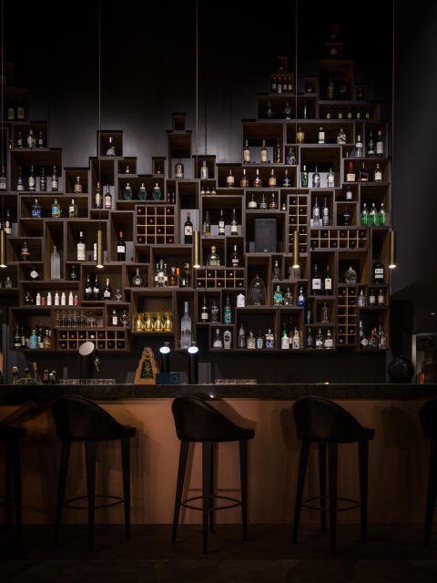 The bar at HUUS Hotel, Gstaad, designed by Stylt Trampoli