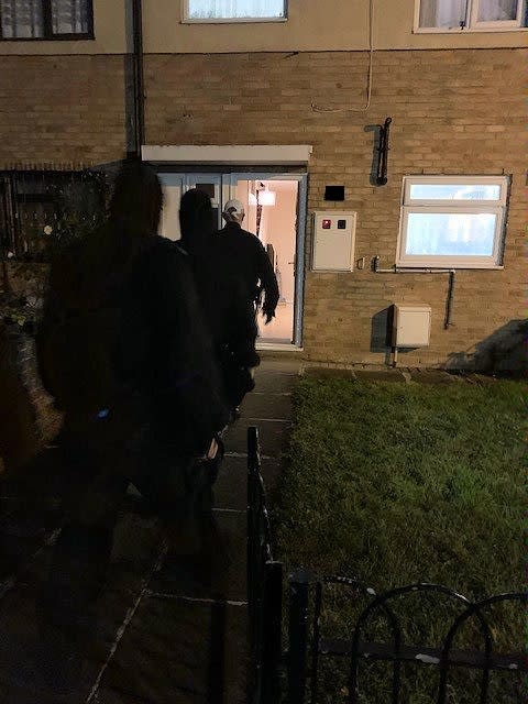 Officers enter an address in Clayhall - Op Linstock