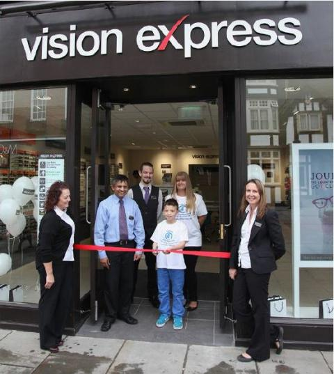 ​Hitchin eye cancer youngster opens new Vision Express store