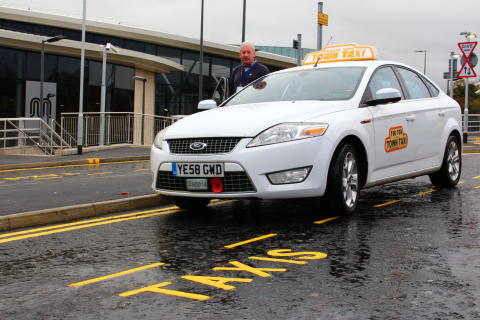 Easy acess: Cab driver Keith Watson pulls up next to the bus station