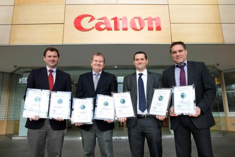 Photos of the Canon team and BLI team with certificates