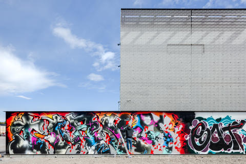 Kalasatama electricity substation and Suvilahti graffiti fence