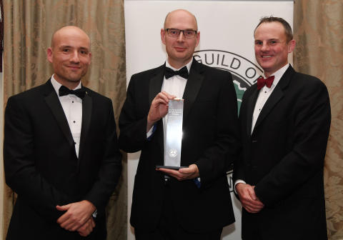Director of Research Matthew Avery (centre) collects the Kia Special Commendation Award from Guild of Motoring Writers Chairman Richard Aucock (L) and Kia Commercial Director Simon Hetherington (R)