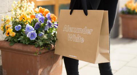 Avisera levererar bärkassar till Alexander White
