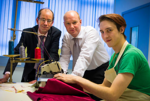 TALENTED trainee: Jonny Carroll (right) showing off his sewing skills to Councillor