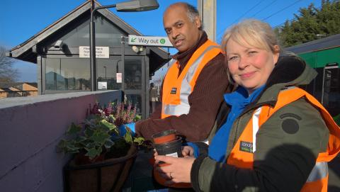 Kerry Evans, Team Leader at Park Lane Garden Centre, helps adopter Anthony with the new planting at Aston station.