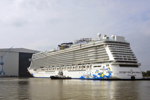 Norwegian Escape floats out from building dock