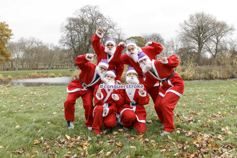 ​Thousands of Santas 'Ho Ho Ho' to the finish line in a festive fun run