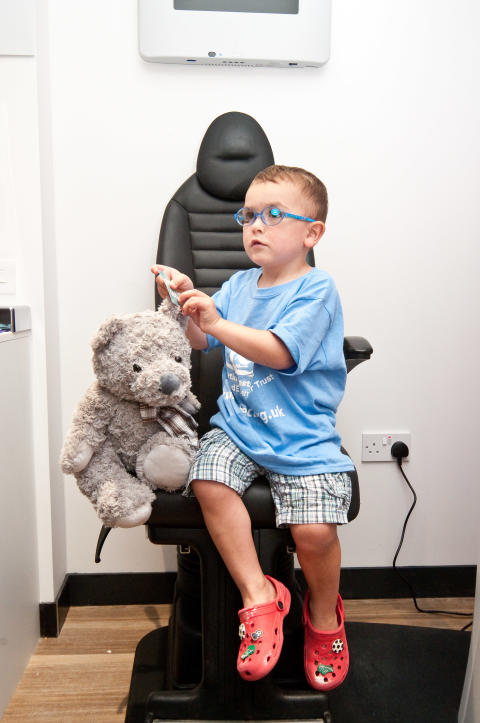 Brighton mum and son share family battle with rare eye cancer during Burgess Hill optician relaunch