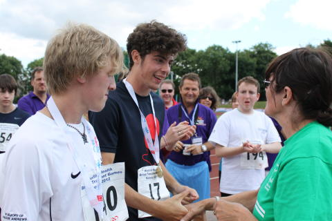Matthew Salkeld receives his gold medal for the long jump