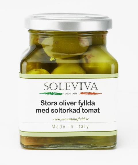 Stora oliver fyllda med soltorkad tomat