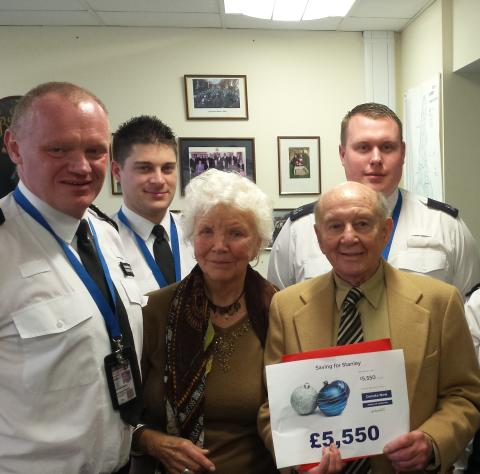 An image of Stan being presented with his cheque.